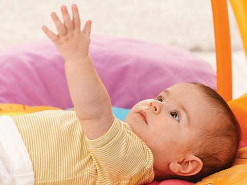 baby grasping for toys