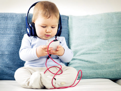baby listening and watching phone