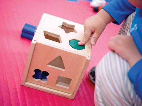 toddler pushing in shapes