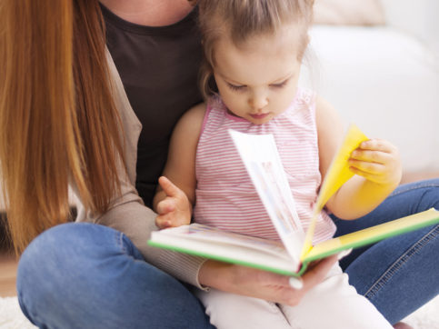mom and baby reading a book