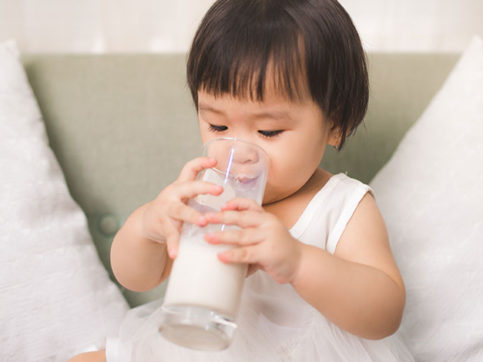 baby drinking milk on the sofa